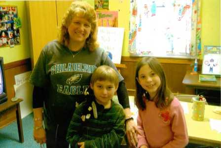 Pictured is Mrs. Anna Meyers - Grades 1 thru 3 teacher, pictured with two of her students Joey and Jackie that have since moved up to Mrs. Pam Holland's class, teacher for Grades 4 thru 6.